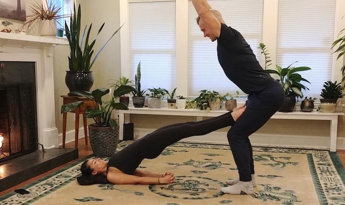 Chair and Shoulder stand Pose for two people