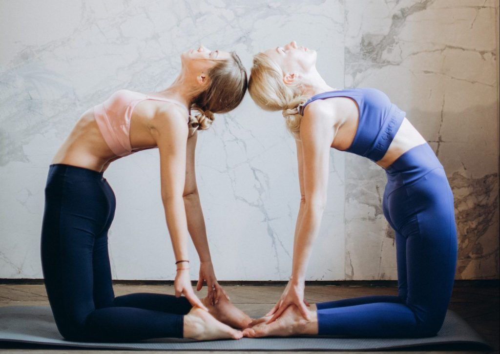 Double Camel Yoga Pose for two people