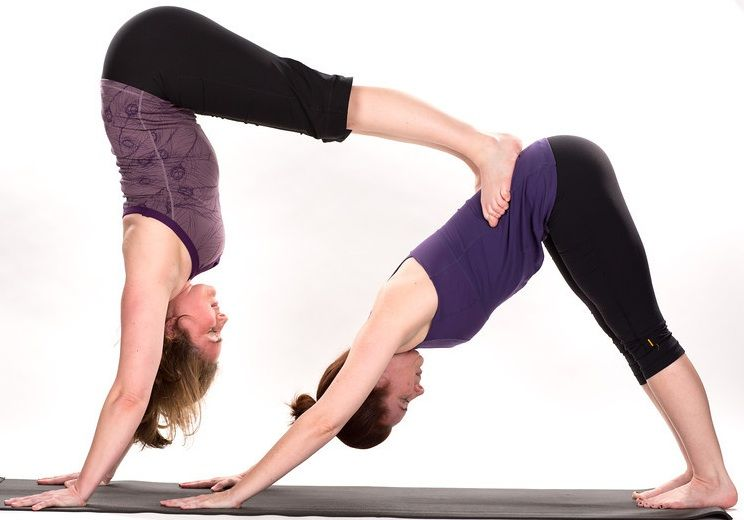 Double Downward Dog Yoga Pose for two persons