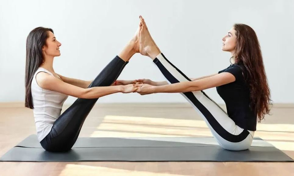 Double Boat Yoga Pose for two people