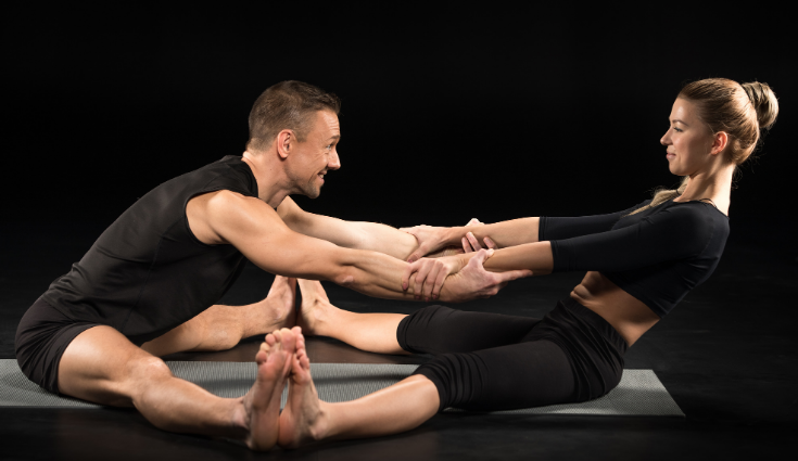 Partner Forward Fold yoga poses for two people